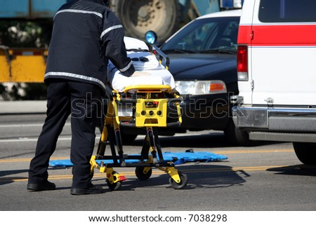 Emergency personnel pushing a stretcher - stock photo