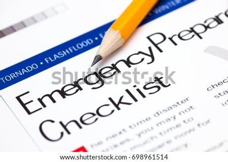 Emergency Preparedness Checklist with pencil. Close-up. #698961514