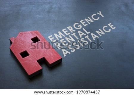 Emergency Rental Assistance Program ERAP. Red wooden home on the blackboard. Stock foto ©