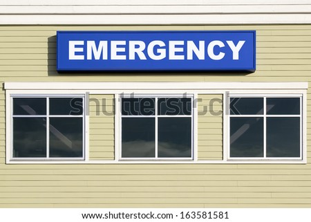 Emergency Sign Above Windows Outside Hospital or Emergency Clinic Building