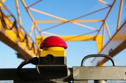 Emergency stop button on container crane
