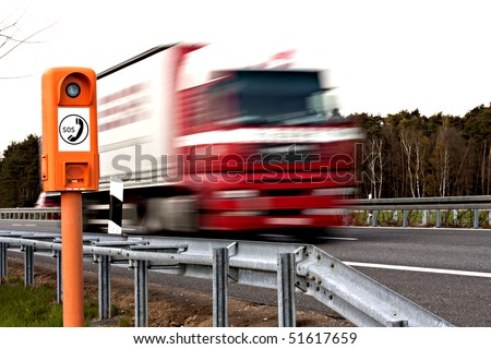 emergency telephone at highway and driving truck