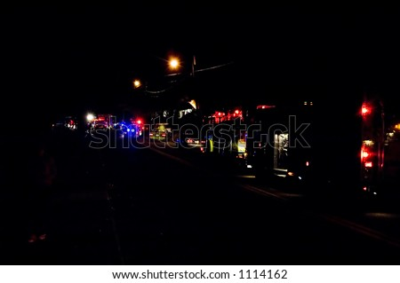Emergency vehicles at a house fire