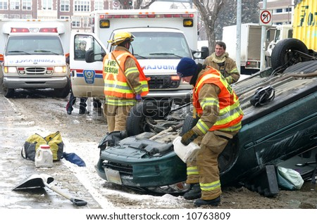 Emergency workers respond to a single vehicle rollover.