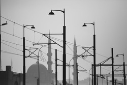 Eminönü, Istanbul. Galata Bridge tramway line. New Mosque view. Silhouette of electric poles, mosque and tramway line