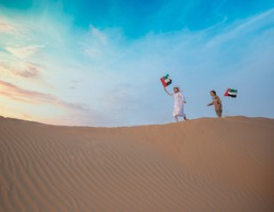 emirates kids are playing in desert