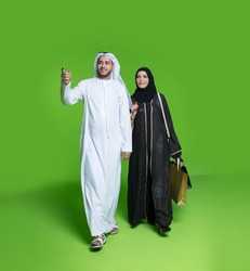 Emirati couple carrying shopping bags