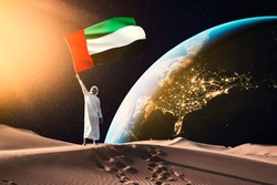 emirati man holding UAE flag standing on the moon