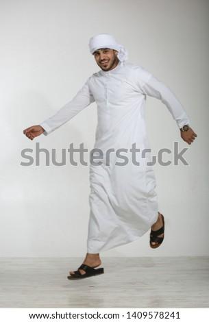 Emirati man jumping in studio