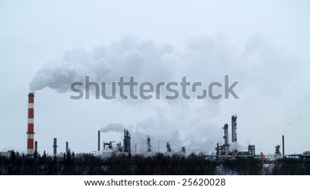 Emissions vent from an older refinery, east side of Edmonton, Alberta.  Much of the oil sand mined at Fort McMurray, Alberta is processed here, 440 kms to the south of the resource.