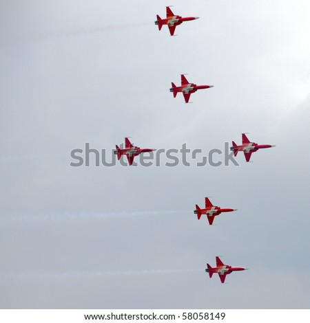 EMMEN, SWITZERLAND - JULY 24: Air acrobatics group Patrouille Suisse shows the formation cross on Northrop F-5E Tiger IIs at the Airshow \