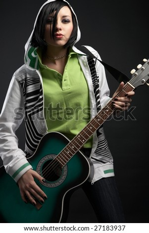 emo girl with guitar on black background