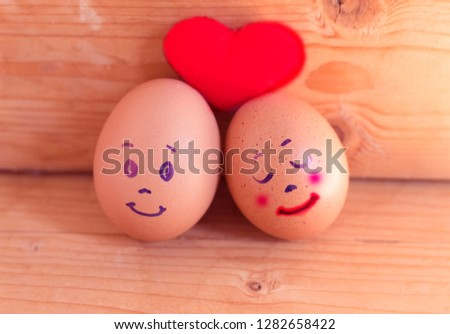 emoji face on eggs with red heart in valentine concept #1282658422