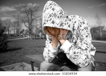 Emotion conceptual image. Depressed teenager.