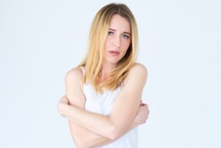 emotion face. downhearted depressed rueful frustrated sad woman. young beautiful blond girl portrait on white background.