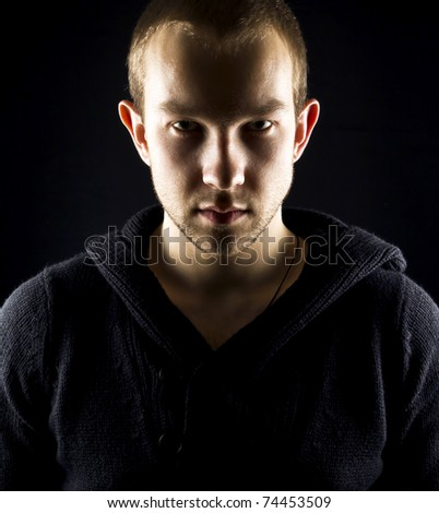 emotional assassin with gloves - stock photo