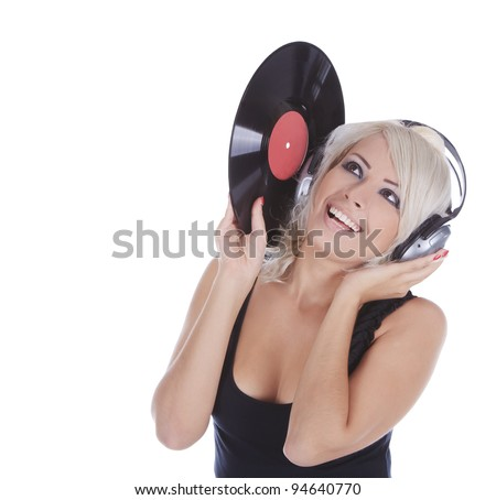 emotional blonde in headphones with vinyl record over white