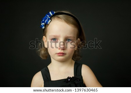 Emotional child with tears - a young girl crying, fine art portrait