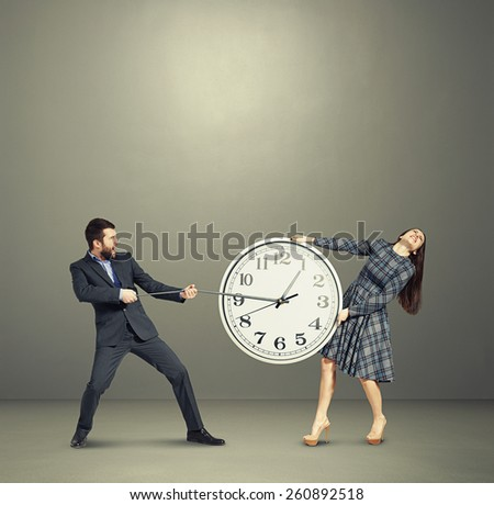 emotional couple stretching out the clock and screaming over dark background