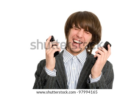 Emotional crying young stockbroker for two mobile phones.