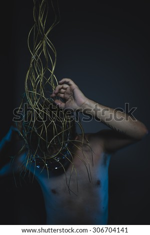 emotional, depression and anxiety, naked man with a crown of thorns on his head