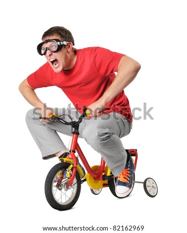 Emotional funny man on a children's bicycle isolated on white background