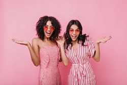 Emotional girls make surprised face expression. Lady in summer pink sunglasses posing for studio portrait