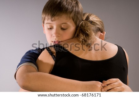 Emotional hug, boy with his mom