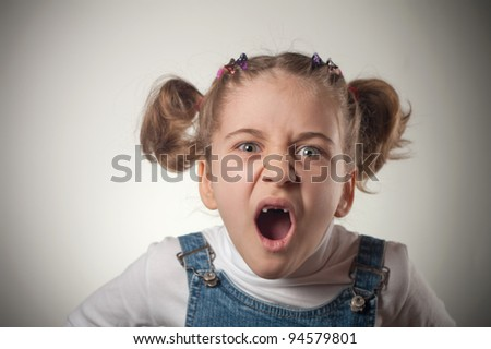 Emotional image of a little girl screaming - stock photo