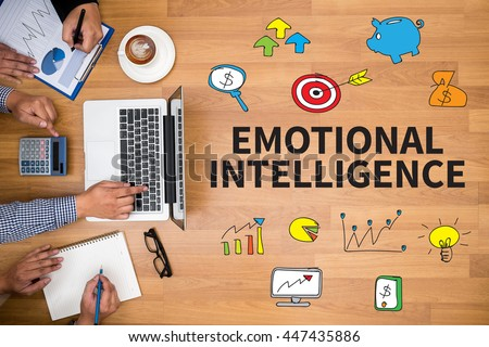 EMOTIONAL INTELLIGENCE Business team hands at work with financial reports and a laptop #447435886