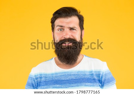 Emotional intelligence. Man bearded stylish beard yellow background. Barber services. Hairdresser salon. Fancy mustache. Male portrait. Barber tips. Beard and mustache. Hipster style. Beard fashion.
