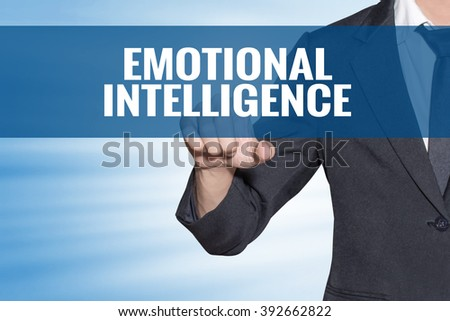 Emotional Intelligence word Business man touching on blue virtual screen #392662822