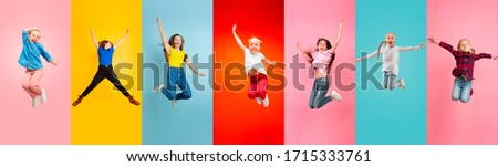 Photo of  Emotional kids and teens jumping high, look happy, cheerful on multicolored background. Delighted, winning girls. Emotions, facial expression concept. Trendy colors. Creative collage made of 5 models