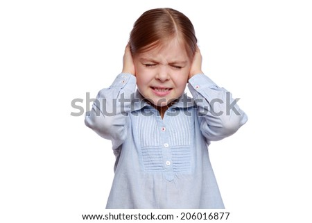 Emotional little girl covered her ears with her hands isolated on white