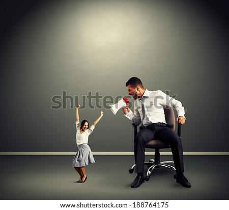 emotional man and happy woman over dark background