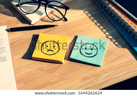 Emotional of human on work life concepts with happy and fail emotion on notepaper.Mental health