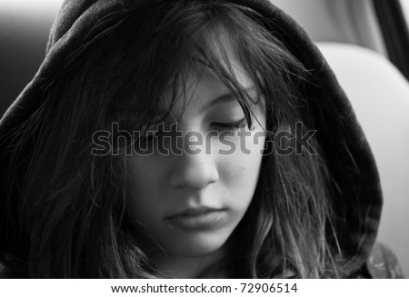 Emotional portrait of a teenage girl looking troubled