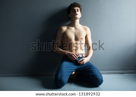 emotional Portrait of a well built shirtless muscular male model