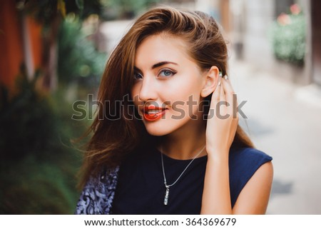 emotional portrait of Fashion stylish portrait of pretty young hipster blonde woman,going crazy,elegant black hat,soft colors,cool crazy  girl.Red urban wall background.surprised girl close up