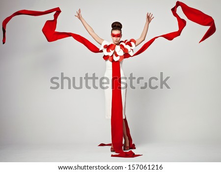 emotional portrait of fashion woman in exclusive dress posing in studio , textile is flying - Shutterstock ID 157061216