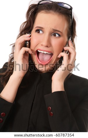 Emotional portrait of young business woman with two mobile phones and crazy expression