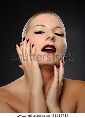 Emotional pretty woman face with bright make-up and violet lipstick screaming