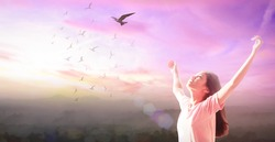 Emotional release concept: Beautiful girl over sky and bird flying sunset background