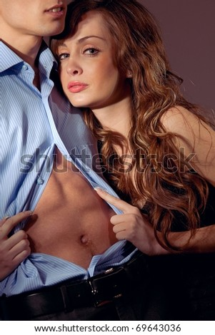 Emotional sexy scene young woman undressing her partner