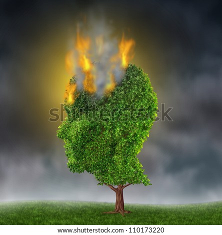 Emotional stress and suffering with a tree in the shape of a human head burning in flames on a night sky as a medical brain concept on extreme anguish and pain of anxiety and depression.