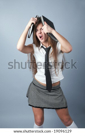 emotional student girl with long hair and black-and-white miniskirt