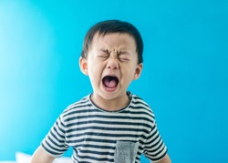 Emotional Tantrum and Angry little boy at home.Stay at home self quarantine at home from covid-19 coronavirus.Depressed toddler complaining.Attention deficit hyperactivity disorder (ADHD) Concept.