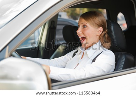emotional woman in panic is driving the car