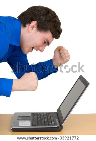 Emotional young man with the laptop on white background