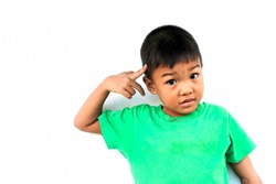 Emotions and expressions of the boy's feelings concept. Asian child boy feel doubt and stressed. He wearing a green shirt on white background. His hand touching his head.